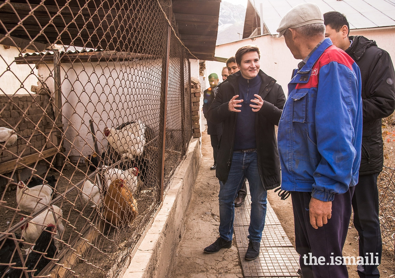 Prince Aly Muhammad visits a local chicken farm owned by Mr Kalyikul Ysyraliev. As a graduate of UCA's Entrepreneurship Programme, Mr Ysraliev built his first greenhouse in 2013 with the support of a loan from the Kyrgyz Investment and Credit Bank and UCA, and has been supplying chickens, eggs, as well as vegetables and roses to the local community for the past five years.