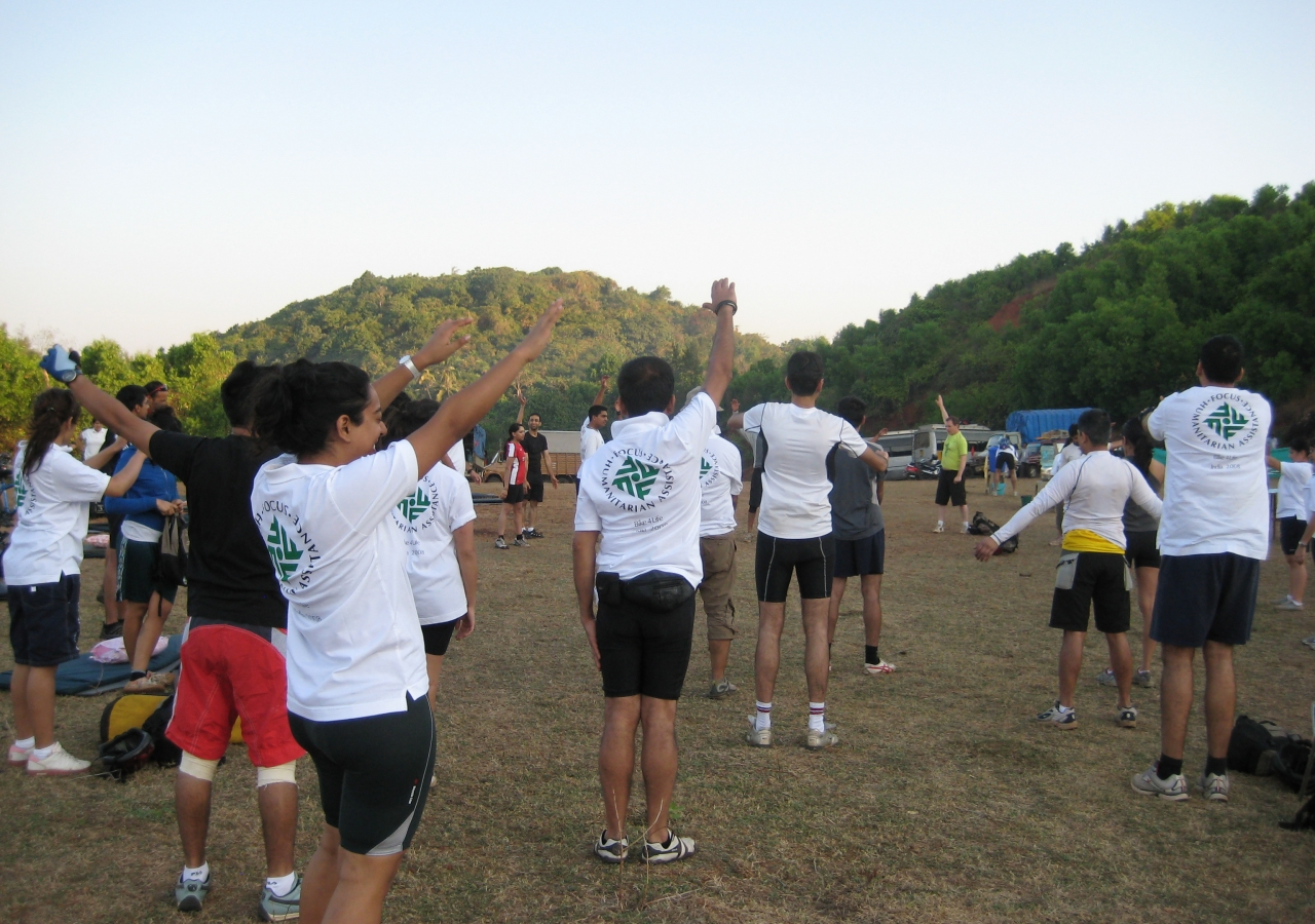 Participants began their day soon after sunrise, with warm-up exercises to get limber ahead of the day's cycling.