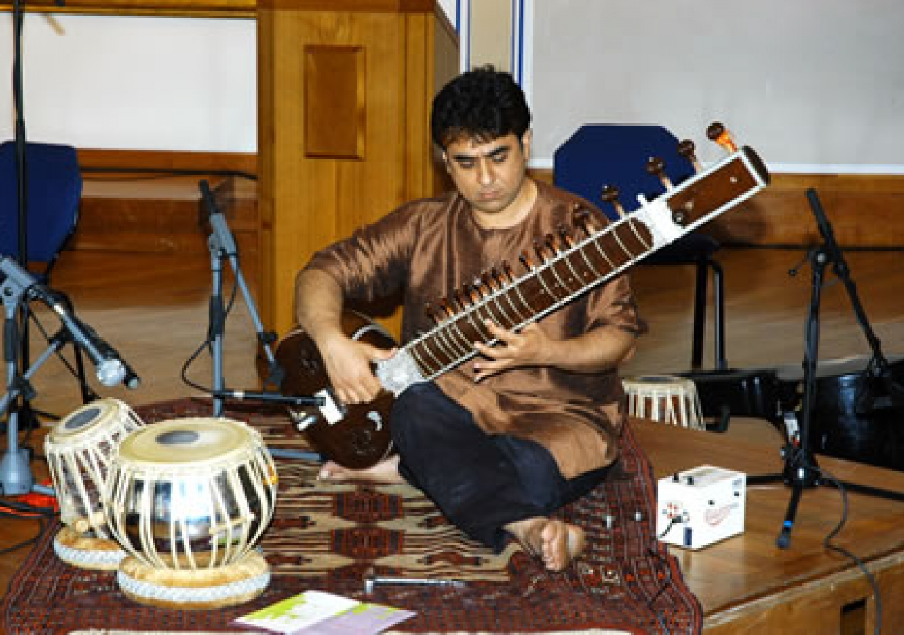 Mohammed Assani plays the sitar during the performance of MAQAM