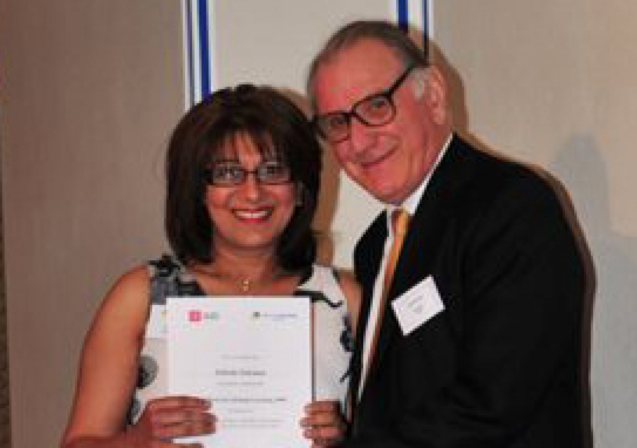 Zubeda Suleman receives her Lifelong Learning certificate from Keith Mackrell, Governor and Honorary Fellow of the LSE.