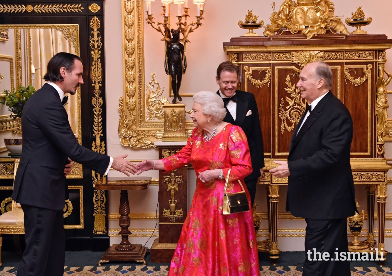 Mawlana Hazar Imam introduces Her Majesty the Queen to his eldest son Prince Rahim.