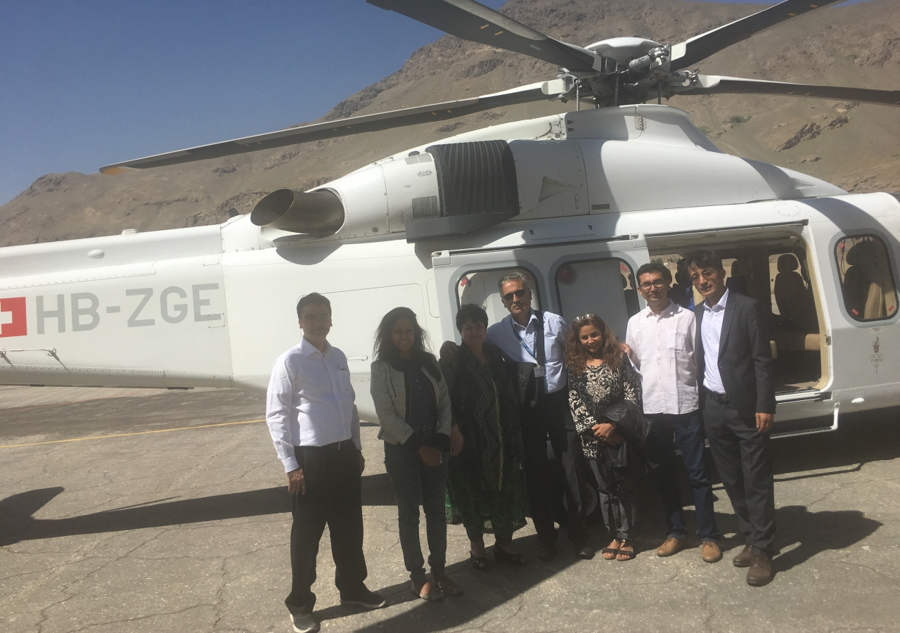 Global QoL Core team arriving in Khorog. From left to right: India Council President Ashish Merchant; Shazmin Dosani, DJI; Former Tajikistan Council President Sharofat Mamadambarova; Helicopter Pilot; Dr. Seema; AKEB India Chairman Aslam Hirani; and Afghanistan Council Vice President Hadi Alizadeh