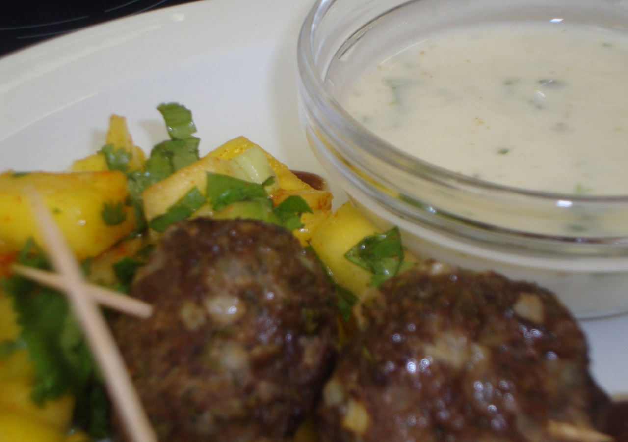 Tasty kebabs that are ready to eat, together with a yoghurt dip.