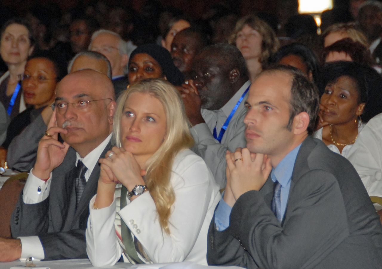 Prince Hussain and Princess Khaliya listen to a session on how Africa has been shaped by its image in the media, together with Ismaili Council for Kenya Vice-President Anwar Hajee.