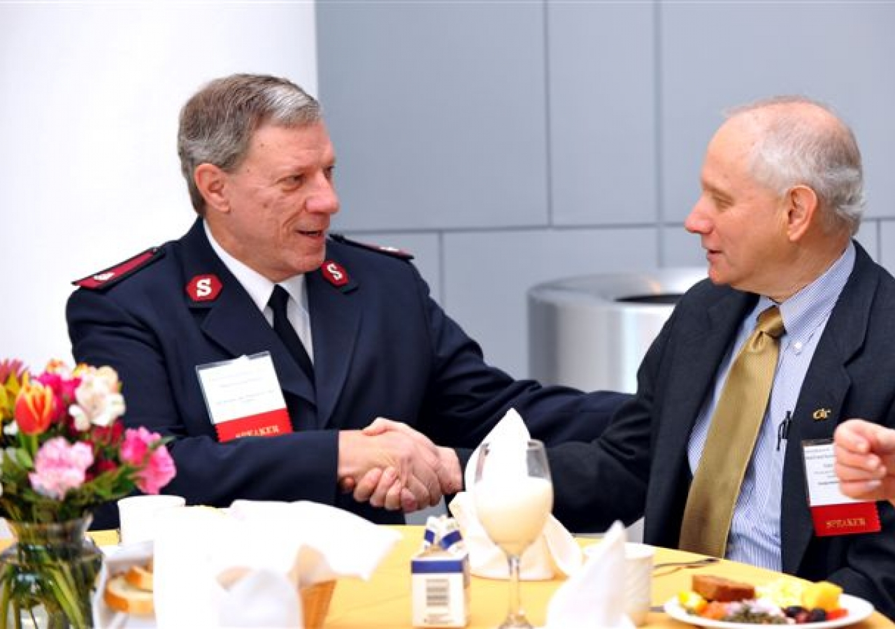 Major George Polarek, Assistant Executive Director of The Salvation Army World Service Office, and Gary Schuster, Provost of Georgia Tech shake hands at the Dignitary Breakfast sponsored by FOCUS.