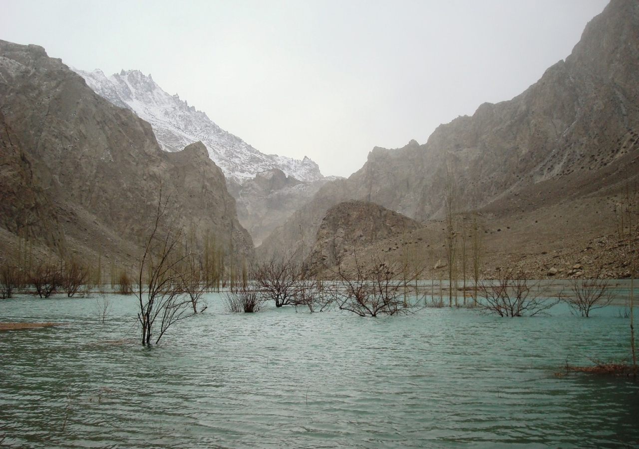 As a result of landslide debris blocking the Hunza River, a 12 kilometre lake has formed, swallowing up arable land, houses and animal sheds in Ayeenabad–Shishkat.