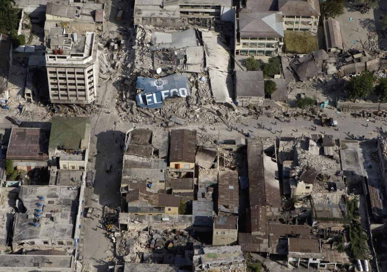 An aerial view of Port-au-Prince's downtown area demonstrates the extent of damage inflicted by the powerful earthquake that hit the Haitian capital on 12 January.
