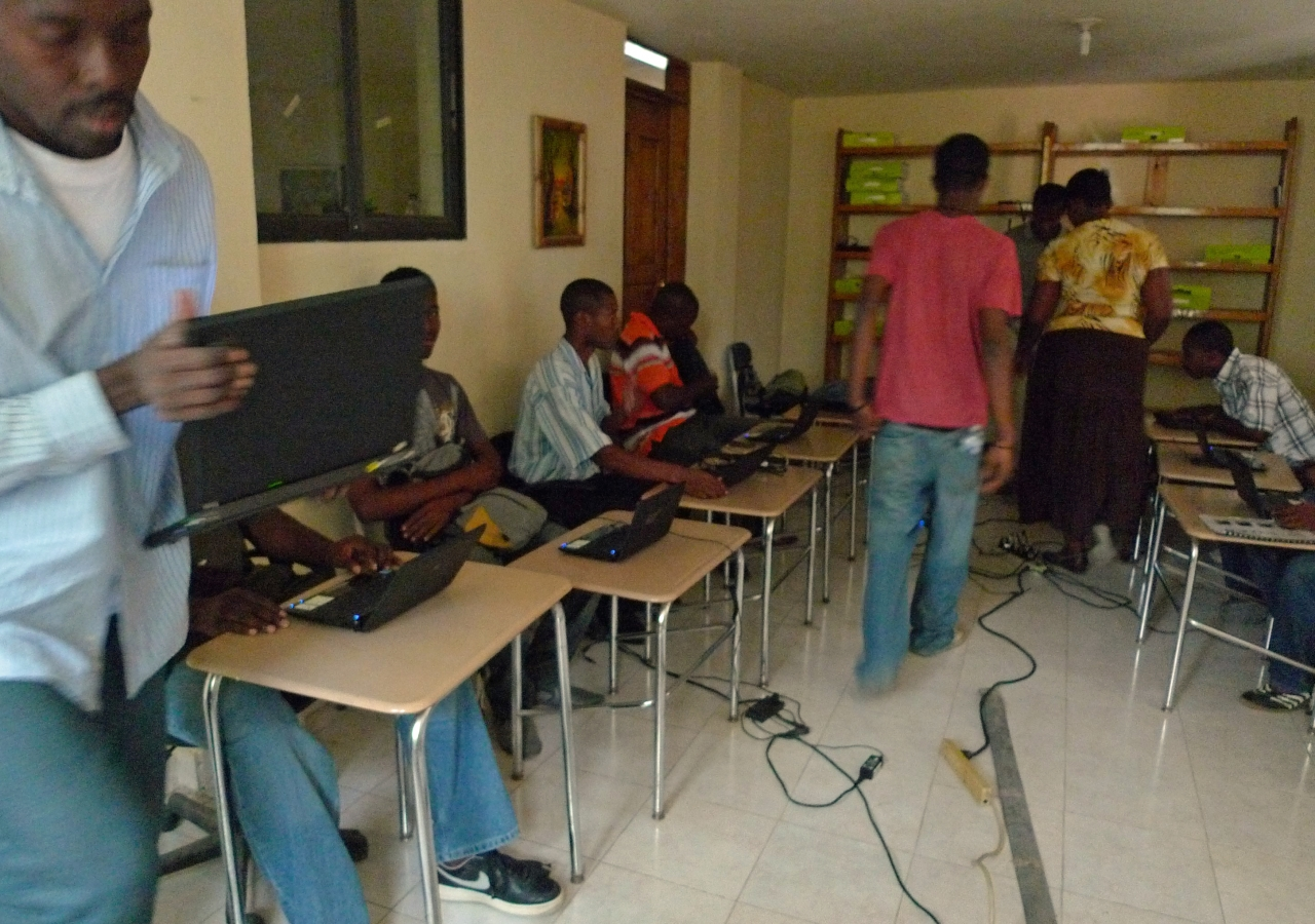 Workers during a training session in Haiti with laptops procured by Samasource.