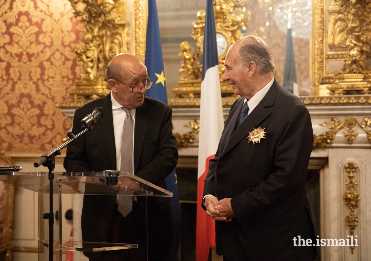 France's Minister for Europe and Foreign Affairs, Jean-Yves Le Drian congratulates Mawlana Hazar Imam for his work over the past 60 years ahead of presenting him the Grand Cross of the Legion of Honour (Grand-croix dans l'Ordre national de la Légion d'honneur).