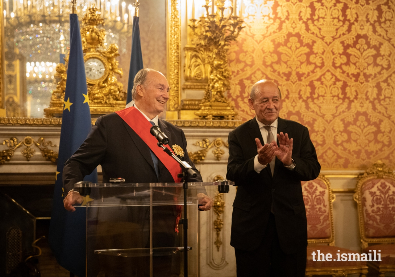 Minister Le Drian applauds as Mawlana Hazar Imam expresses his appreciation to the French government after receiving the country's highest national medal of honour.