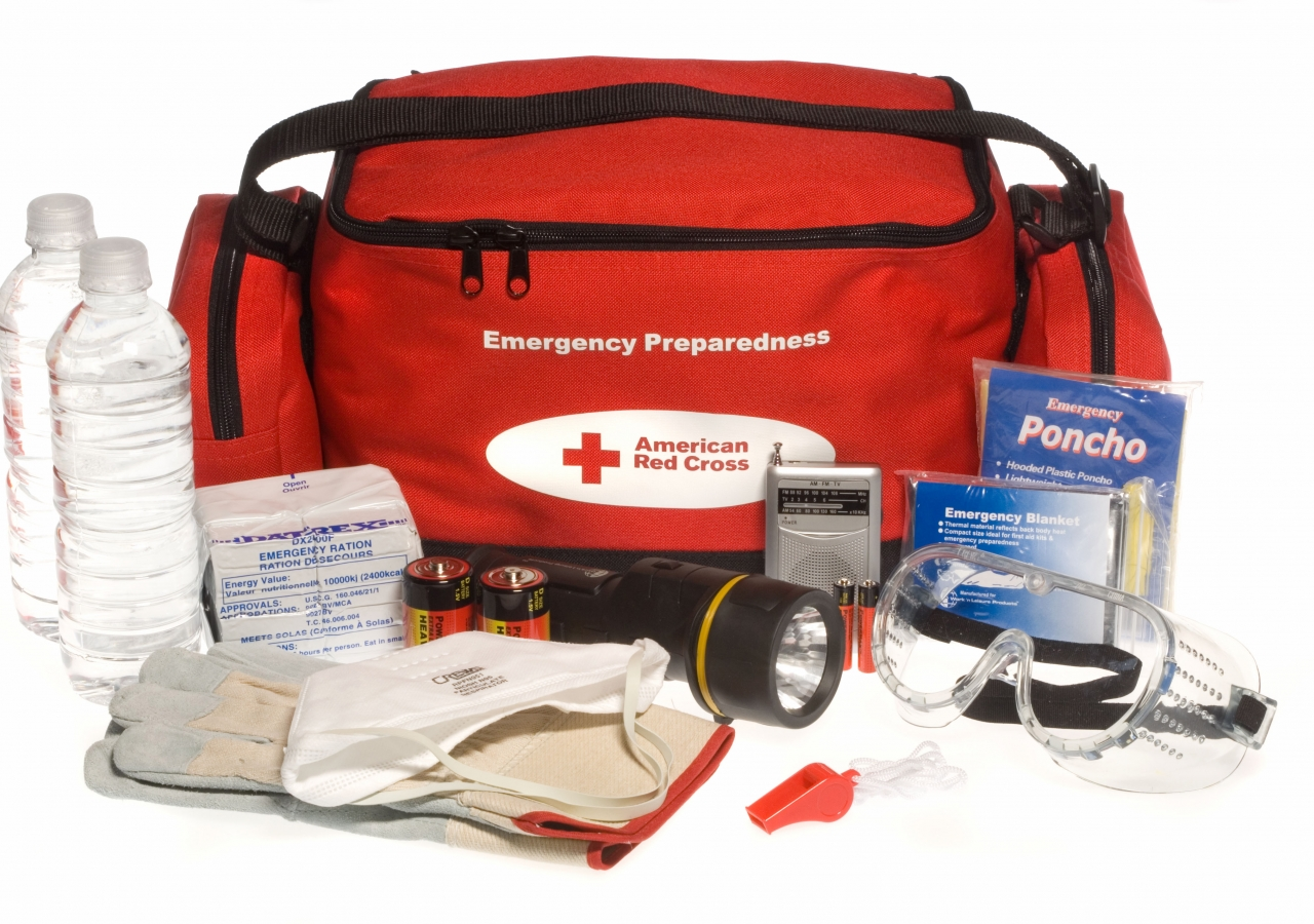 """A Red Cross """"ready to go"""" emergency preparedness kit and its contents."""