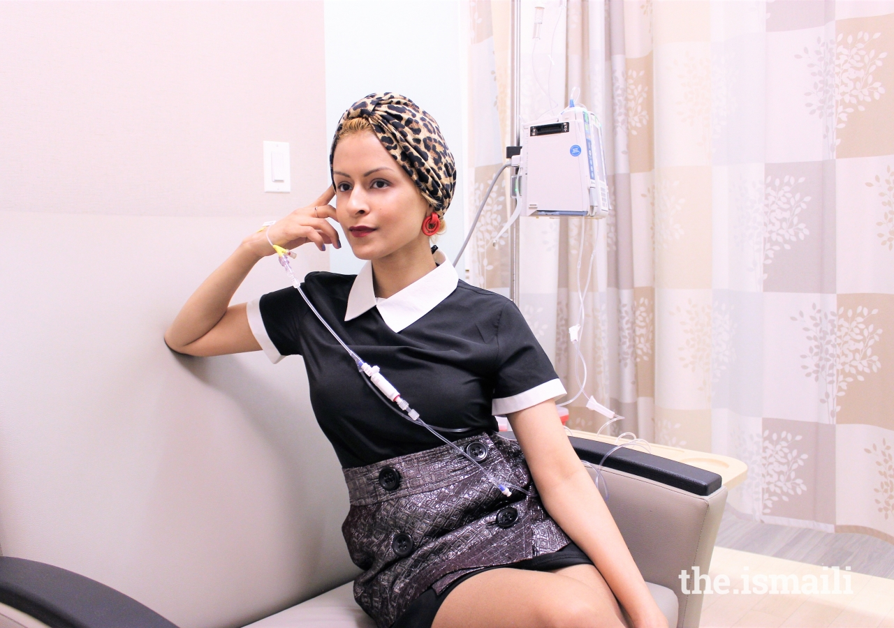 Sonya posing with her fashionable head-wrap at one of her maintenance treatment sessions.