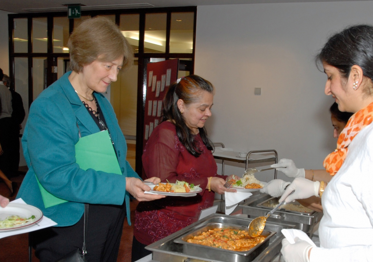 Dr Rowan Hillson, National Clinical Director for Diabetes, samples a healthy version of Chicken Tikka prepared from a Nutrition Centre recipe.