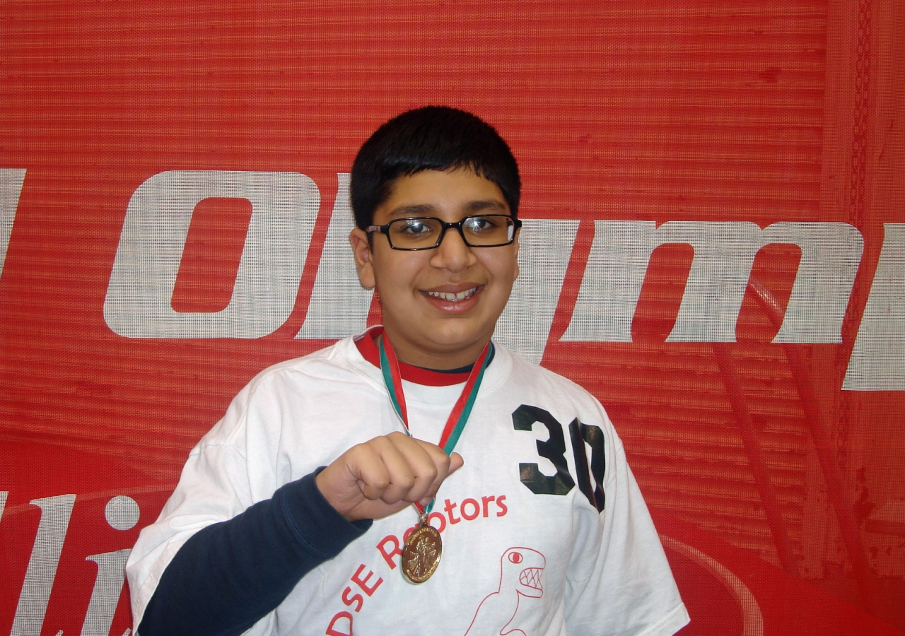 Asad smiles after winning the Gold Medal in Basketball Individual Skills at the 2010 Illinois State Special Olympics.