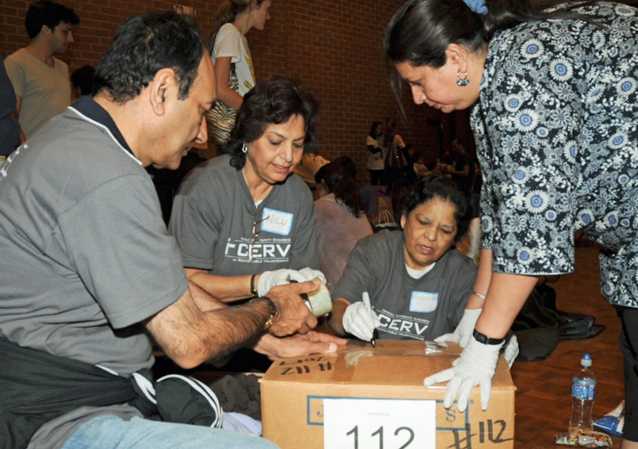 Ismaili volunteers taking part in the USA Jamat's I-CERV programme pack clothes for Ocean Park Community Center in California.