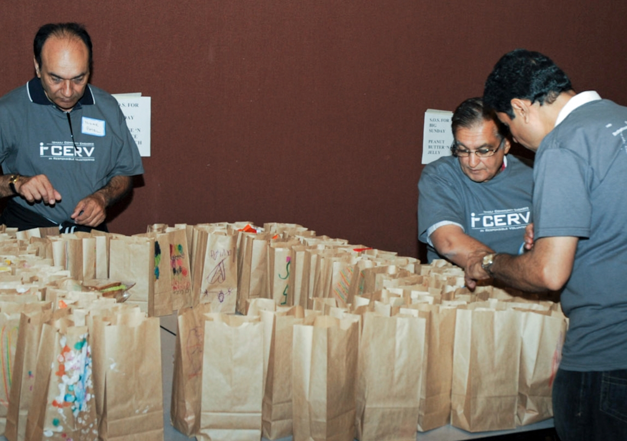 Ismaili volunteers pack food items for a Community Food Resource programme in the United States.