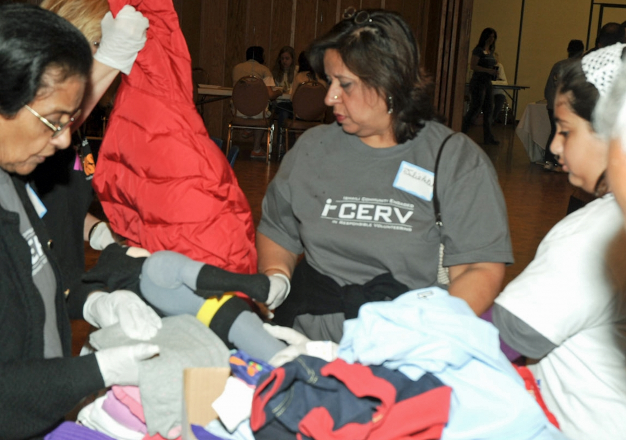 Clothing is sorted for distribution among shelters for homeless families by Ismaili volunteers in the USA participating in the I-CERV programme.