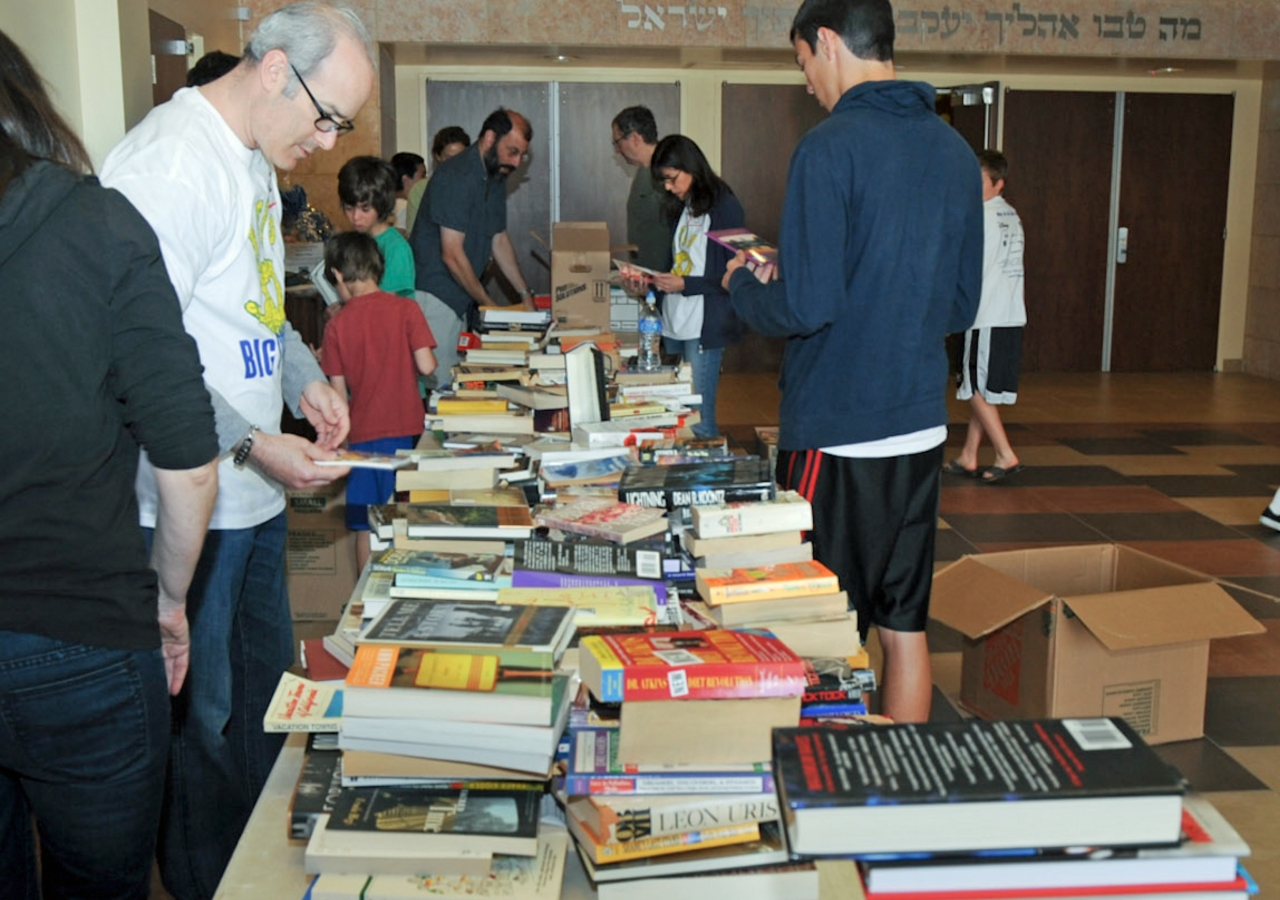 Ismaili I-CERV volunteers sort used books for distribution to inner-city schools in the United States.