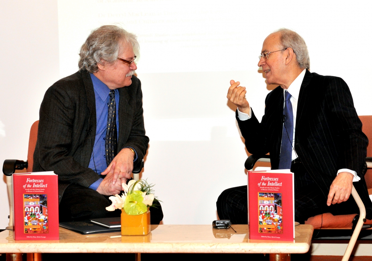 """Dr Farhad Daftary (right) and Dr Derryl MacLean engage in an on-stage conversation as part of the launch of the publication """"Fortresses of the Intellect"""" at the Ismaili Centre, Burnaby."""
