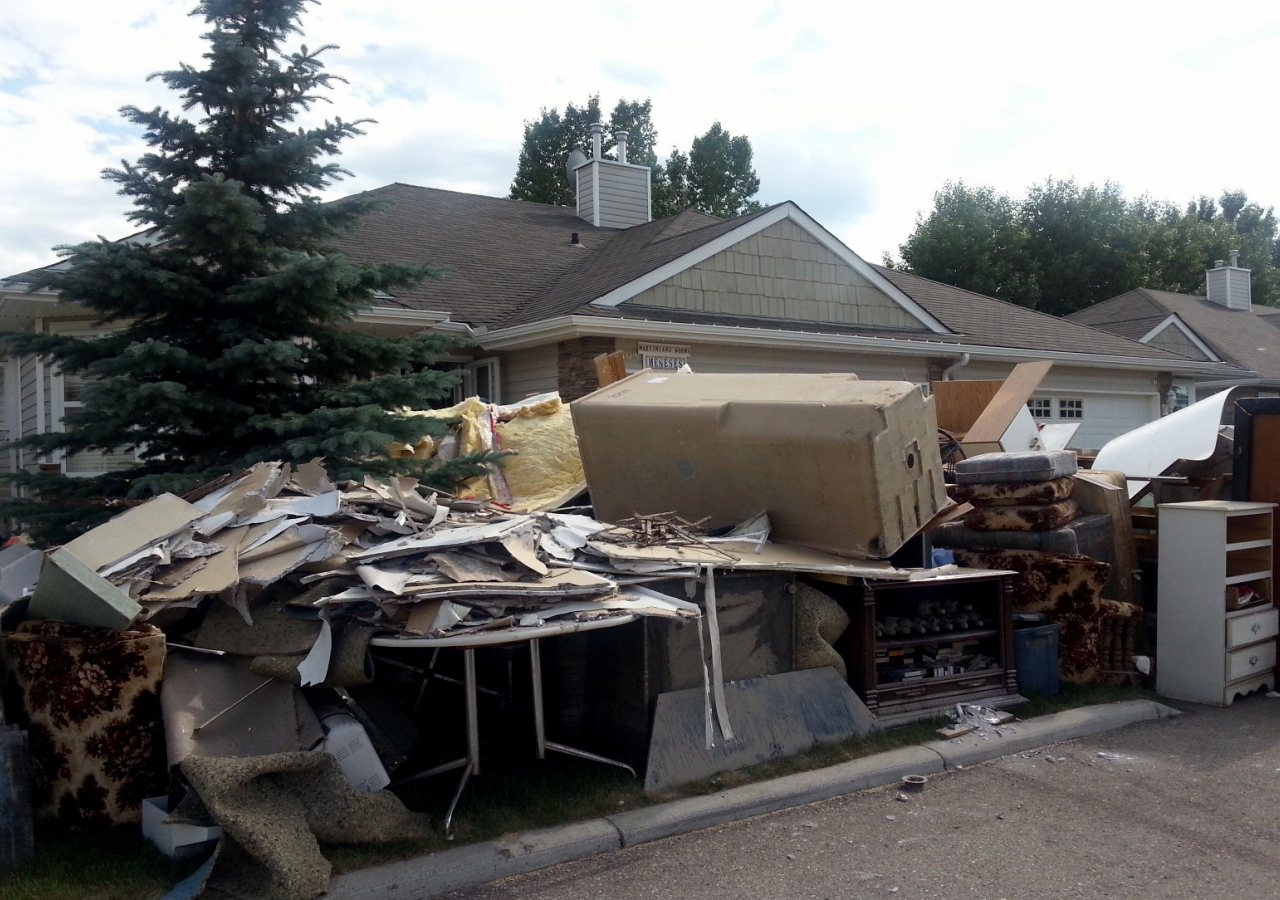 The street in front of homes in High River were piled high with flood debris cleared out from their basements.