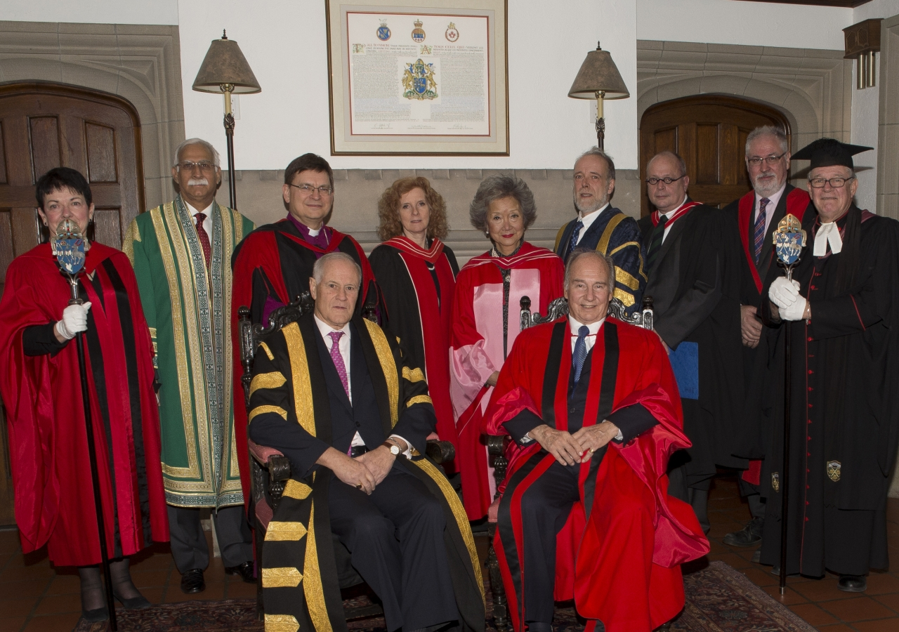 Members of the procession pose for a group photo ahead of the convocation ceremony at Trinity College.
