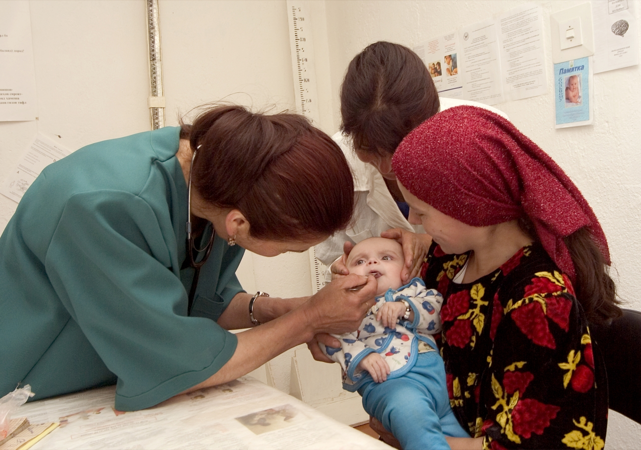 A mother brings her infant for a check-up at one of 18 facilities supported by the Aga Khan Health Services in Rushan, Tajikistan.