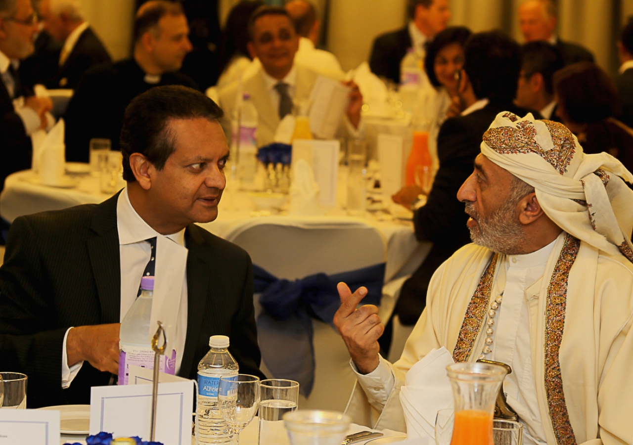 Ismaili Council for the UK President Amin Mawji breaks bread with Yemeni Ambassador, His Excellency Abdulla Ali Al-Radhi at an Iftar dinner hosted at the West London Jamatkhana on 21 July 2014.