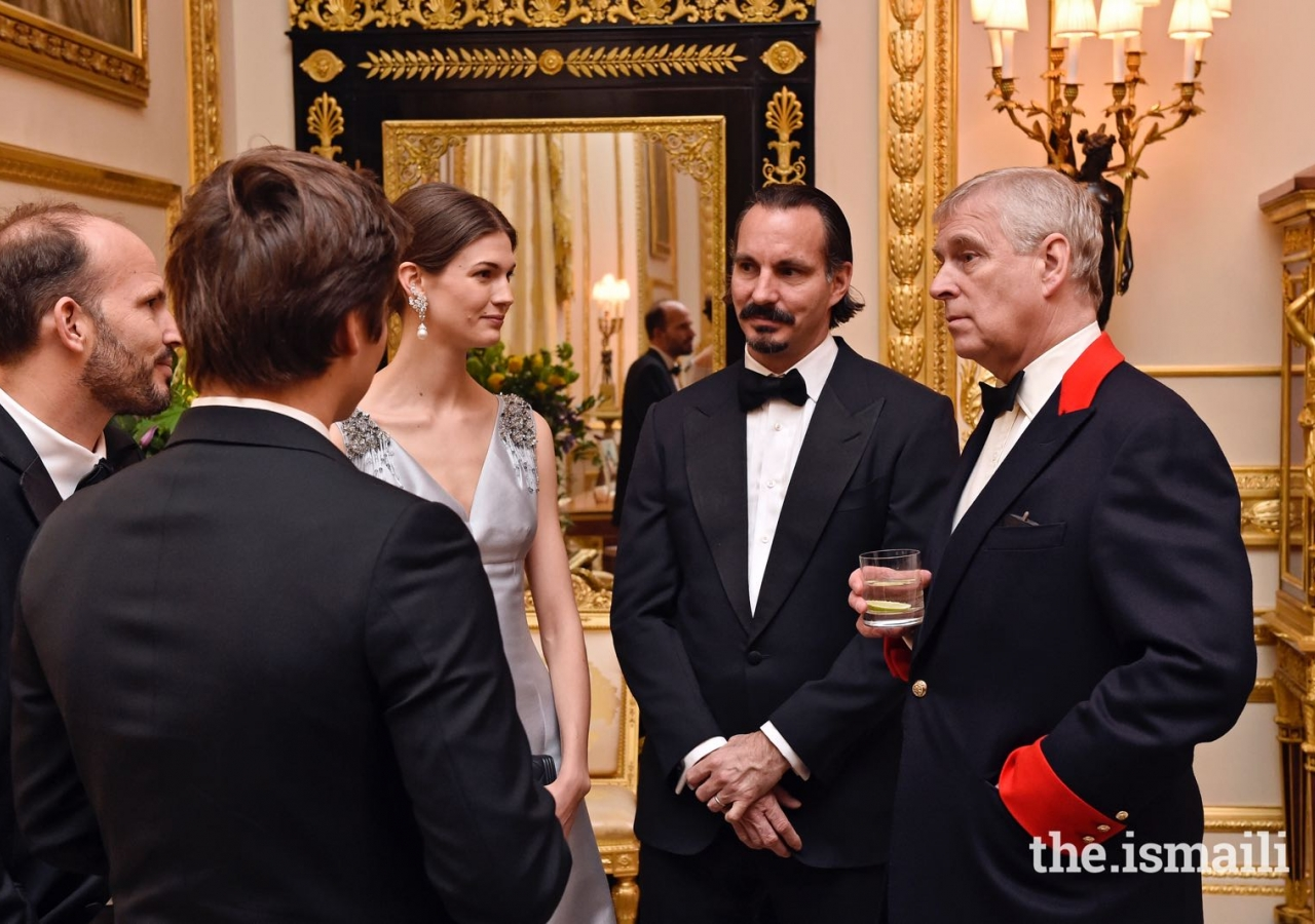 His Royal Highness the Duke of York in conversation with members of Mawlana Hazar Imam's family at a dinner hosted by Her Majesty the Queen at Windsor Castle.