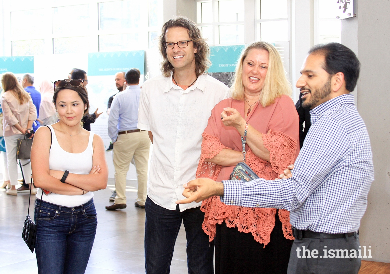 Visitors engage in a discussion at Plano Jamatkhana during the Open House Day.