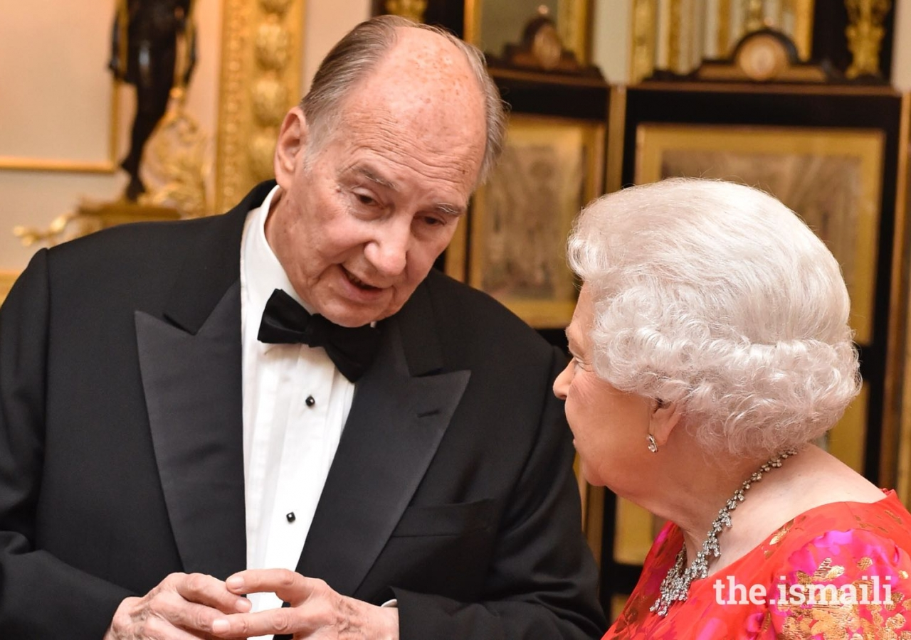 Her Majesty the Queen in conversation with Mawlana Hazar Imam at a dinner hosted by Her Majesty at Windsor Castle.