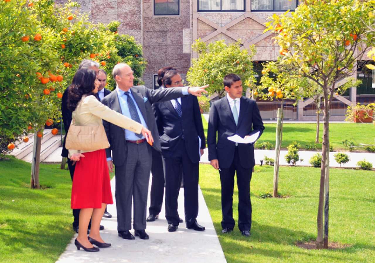 Prince Amyn admiring the orange trees in the gardens of the Centro Ismaili in Lisbon.