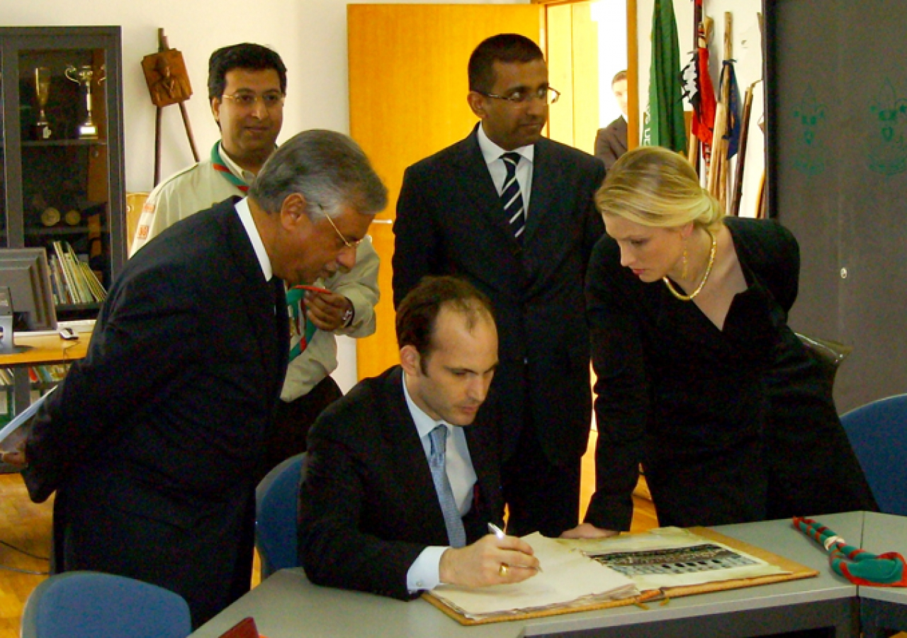 Prince Hussain and Princess Khaliya sign the Visitors Book at the Scouts Headquarters in the Centro Ismaili, Lisbon