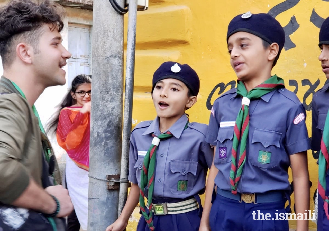 Ibrahim Basha, a GE Expedition participant from Dubai, connects with young Ismaili scouts in Chitravad.