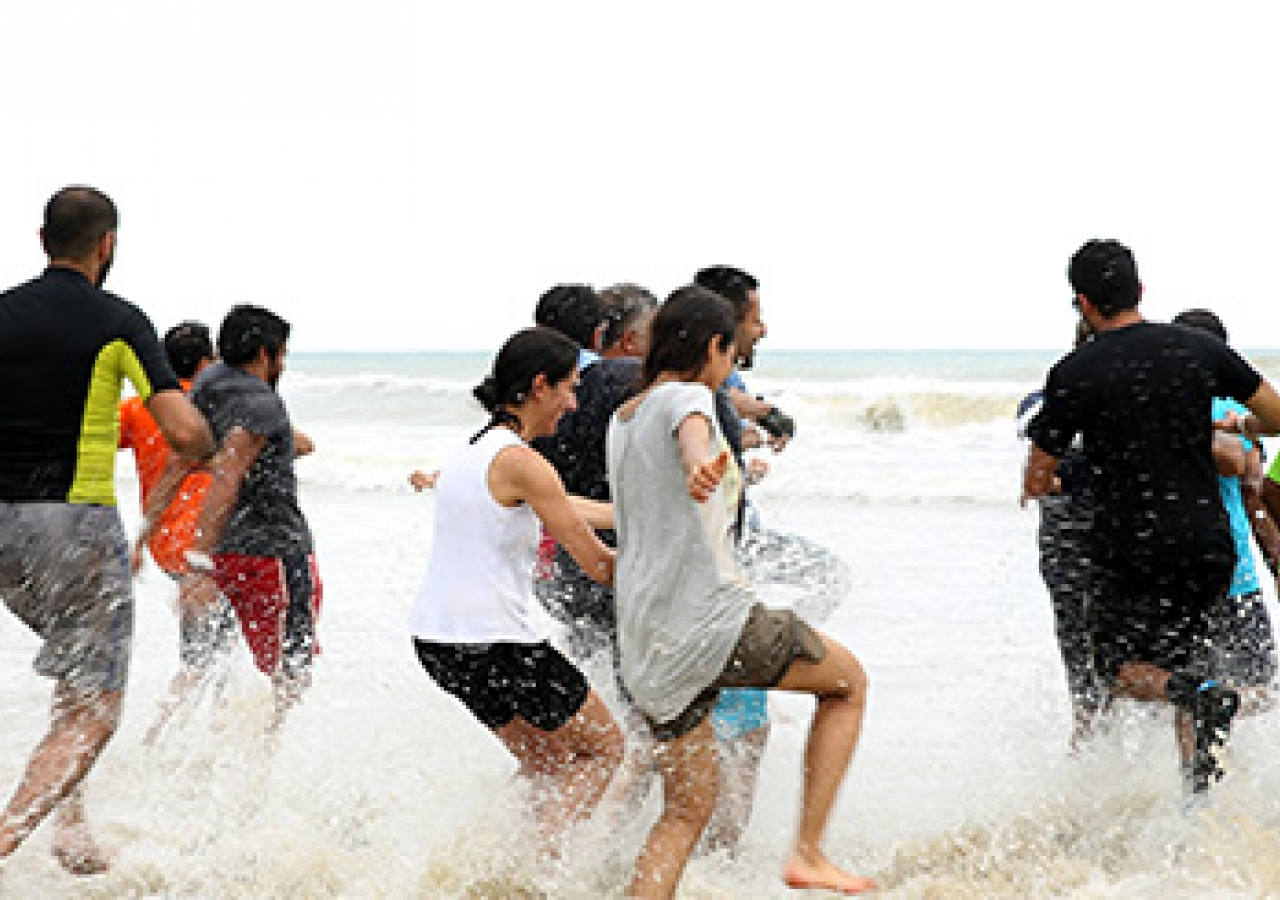 A mad dash into the salty waters of the South China Sea, the symbolic finish line. Alnasir Jamal