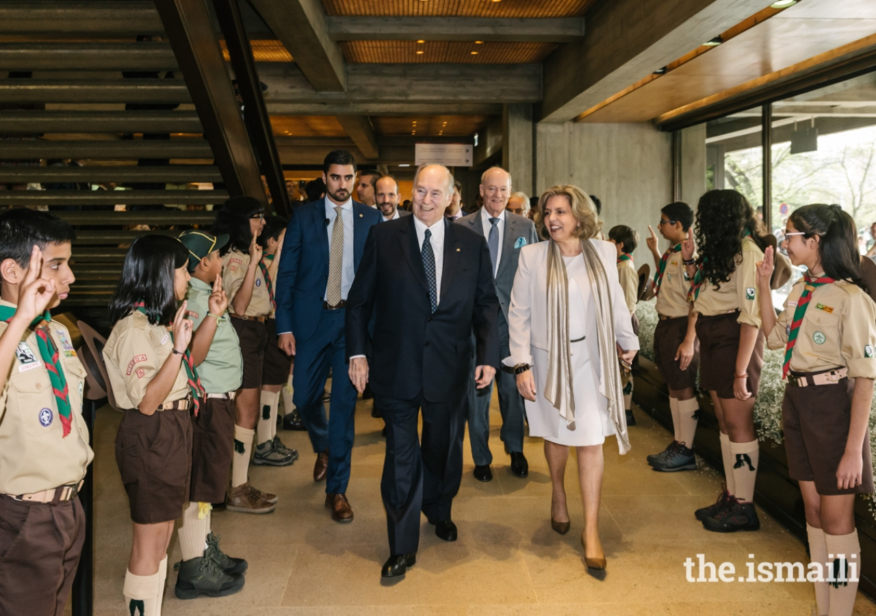 Mawlana Hazar Imam is accompanied by Isabel Mota, President of the Gulbenkian Foundation, as he is welcomed by Aga Khan Scouts upon arriving at the Aga Khan Music Awards Gala Concert and Prize-Giving Ceremony.