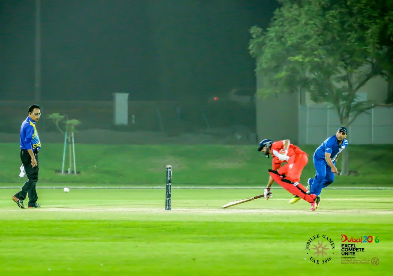 A Team India batsman beats out a throw by a Team Pakistan fielder. Team India scored a total of 128 runs. JG/Shamsh Maredia