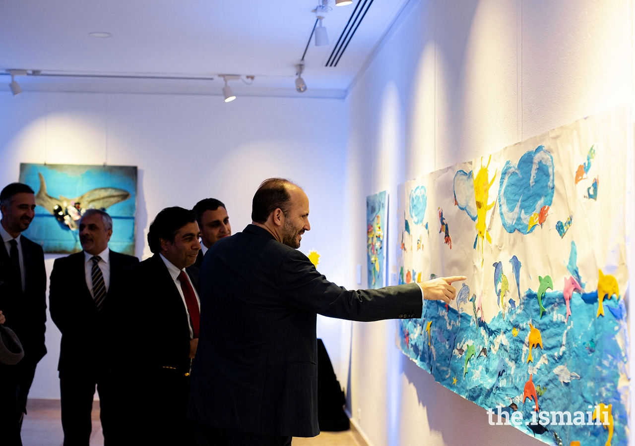 Prince Hussain views artwork designed by students from the Portugal Jamat's Talim (religious education) classes at the Ismaili Centre, Lisbon.