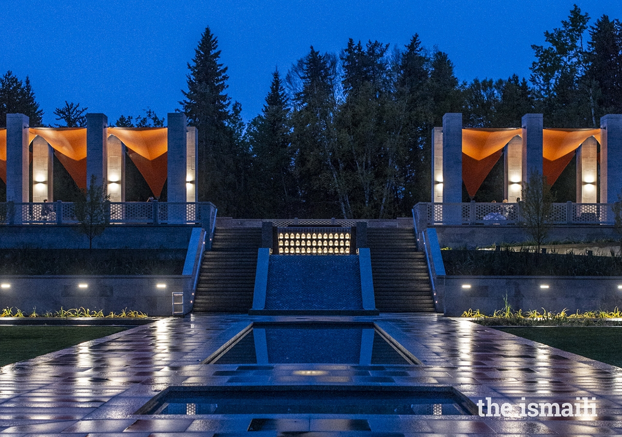 The brilliant burnt orange canopies on the upper Talar columns are lit up at night.