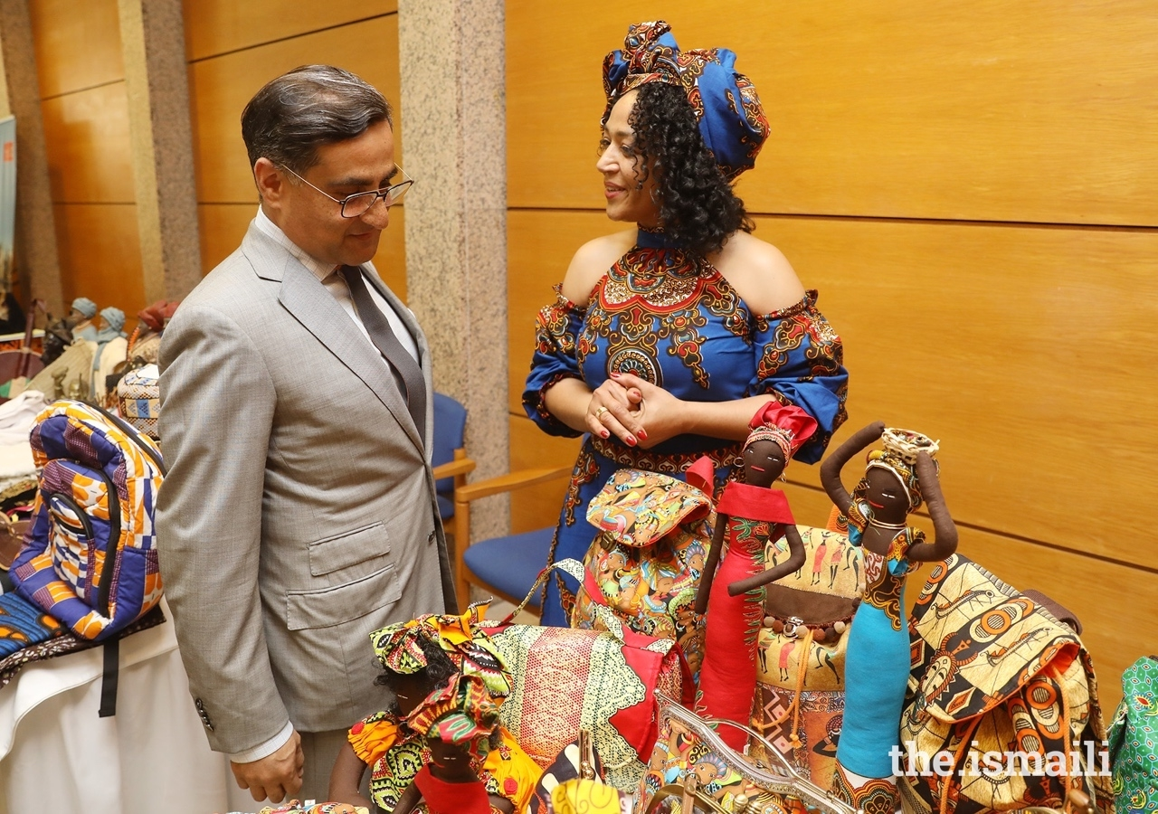 Amin Rawjee, President of the local council for Mozambique, views artefacts at the African craft fair.