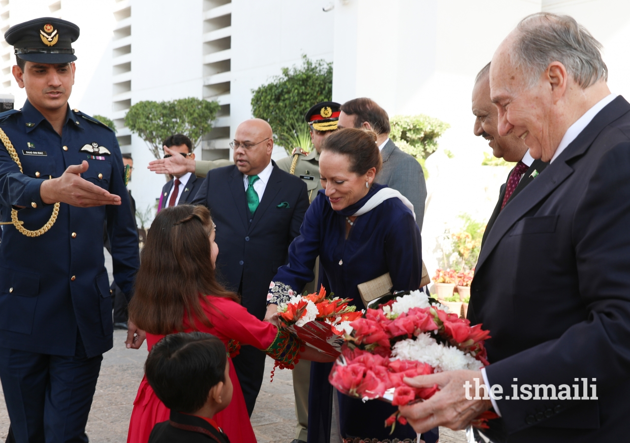 Princess Zahra is presented with a bouquet of flowers upon arrival at the Aiwan-e-Sadr