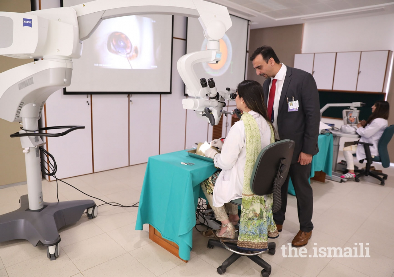 Dr Irfan Jeeva, associate professor in the ophthalmology department, guides a trainee during an eye surgery simulation at CIME's advanced skills simulation lab.