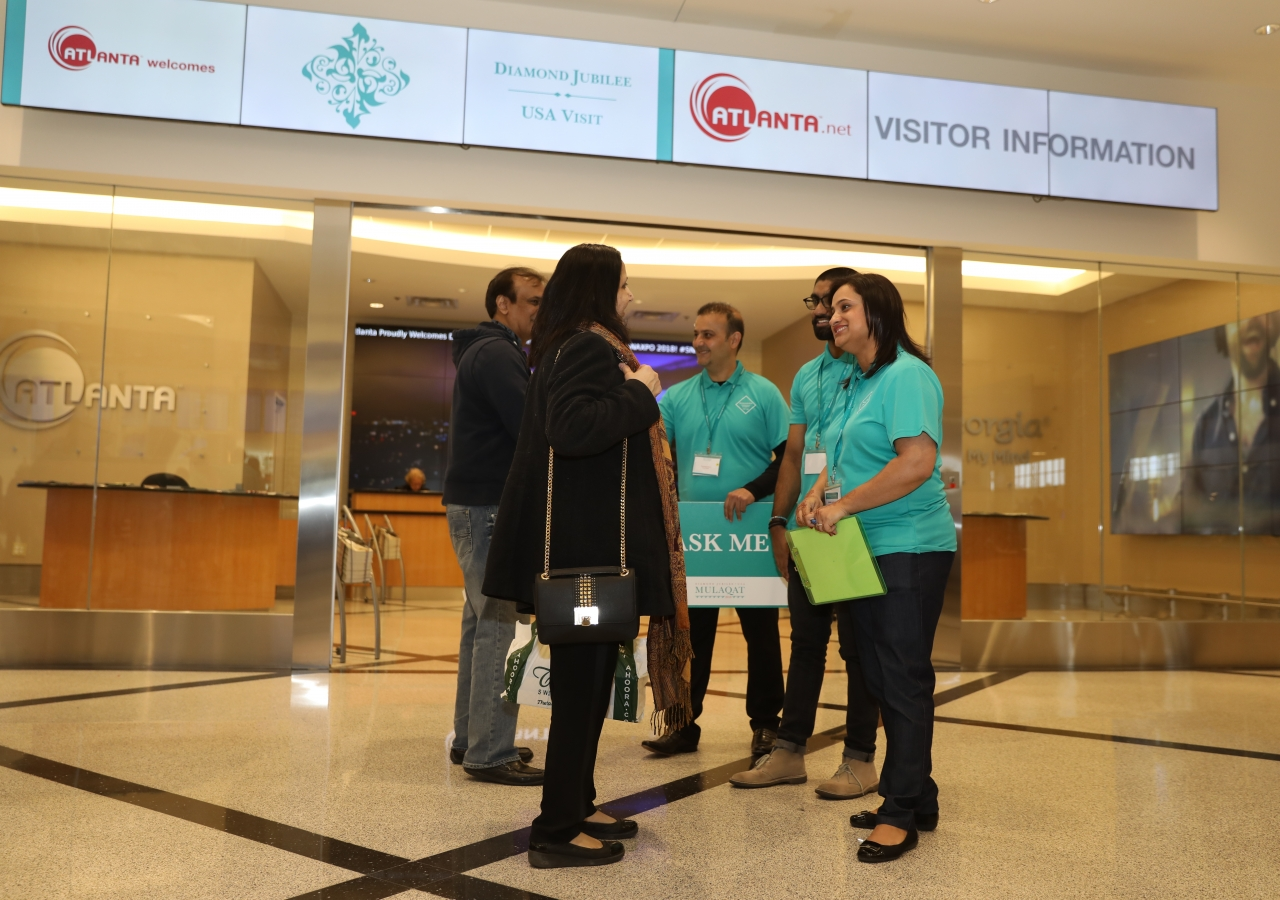 Volunteers greet the Jamat around around the country at Atlanta airport.