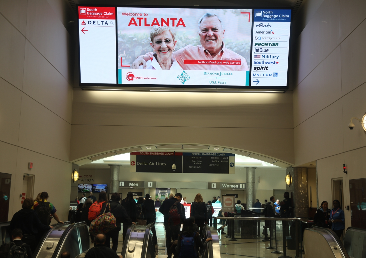 The welcome sign at Atlanta airport, which features the Diamond Jubilee emblem, greets Jamati members upon arrival.