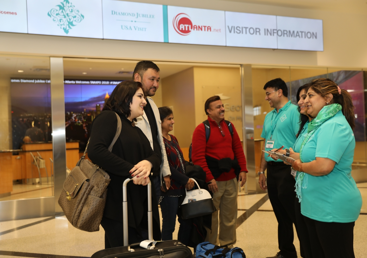 Volunteers welcome Jamati members arriving at Hartsfield-Jackson Atlanta International Airport from around the country for the Atlanta Mulaqat.