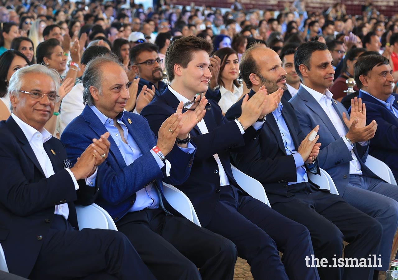 Prince Hussain and Prince Aly Muhammad enjoy an International Talent Showcase performance at Portugal Pavillion Canopy, during the Diamond Jubilee Celebration.
