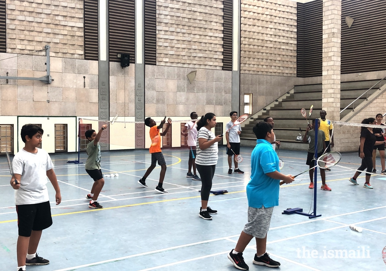 Young students learn the basics of badminton at the Aga Khan Academy in Mombasa.