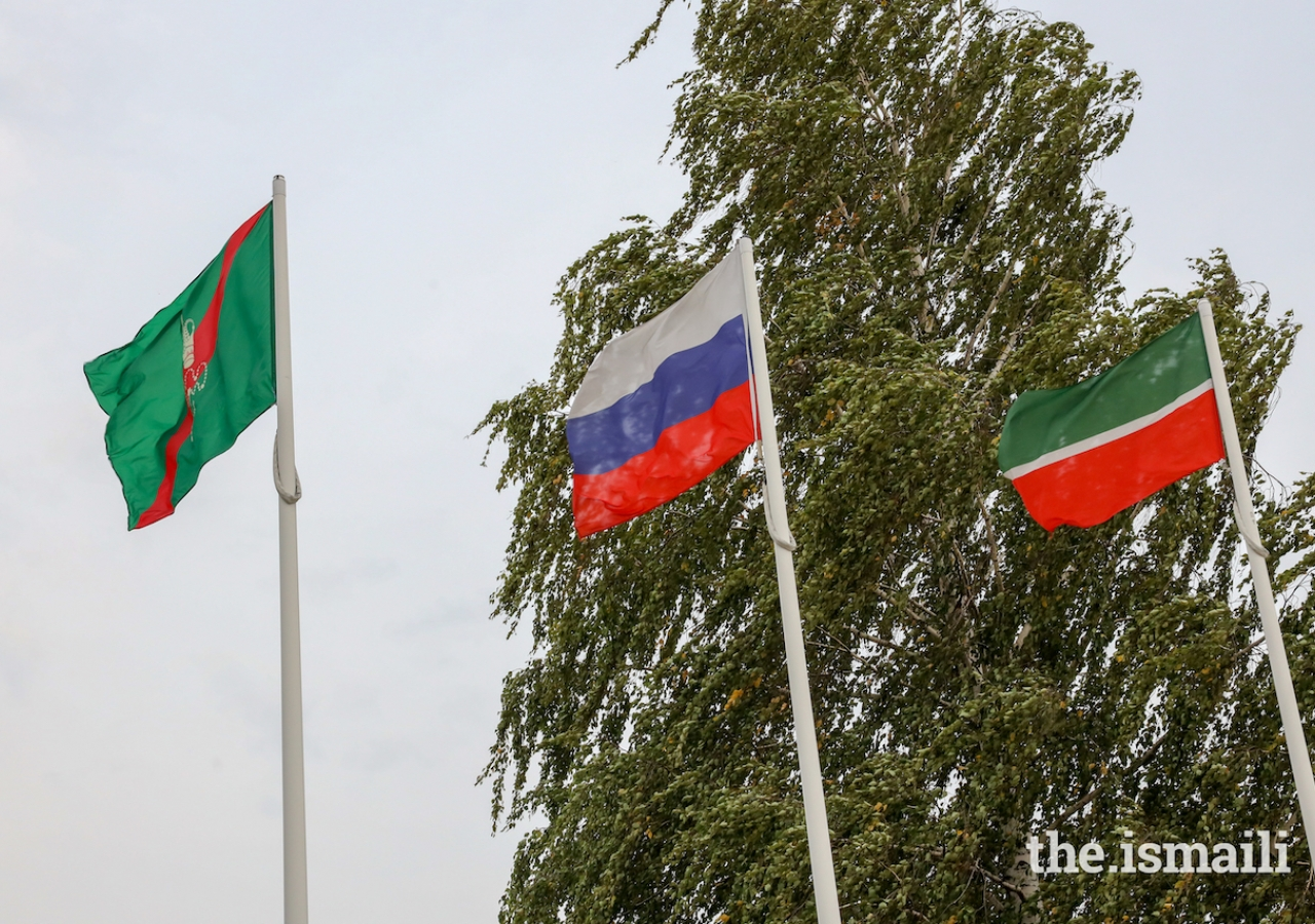 Flags representing the Ismaili Imamat, the Russian Federation, and the Republic of Tatarstan at the Kazan Airport.