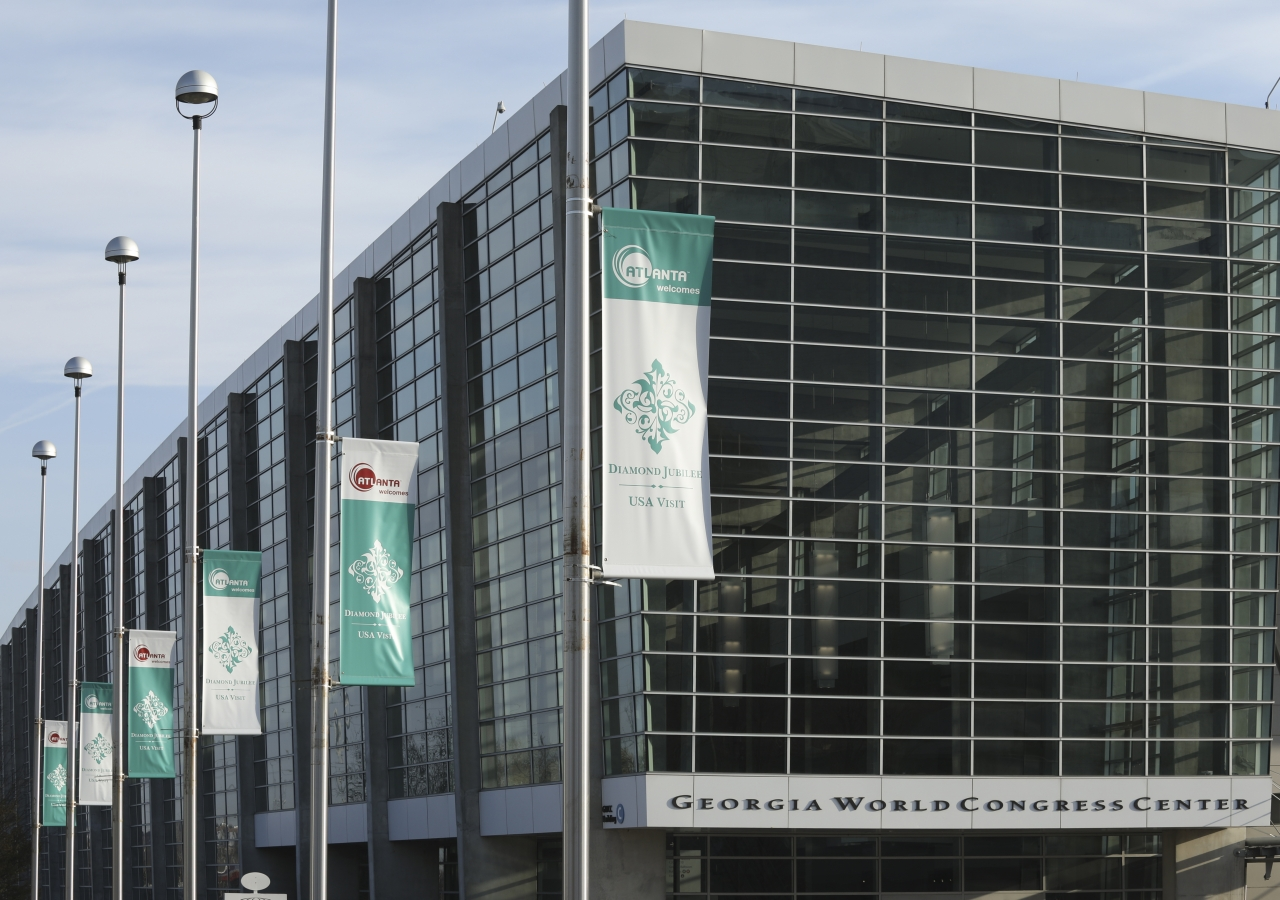 Banners with the Diamond Jubilee emblem decorate the area around the Georgia World Congress Center, the site of the Atlanta Mulaqat.