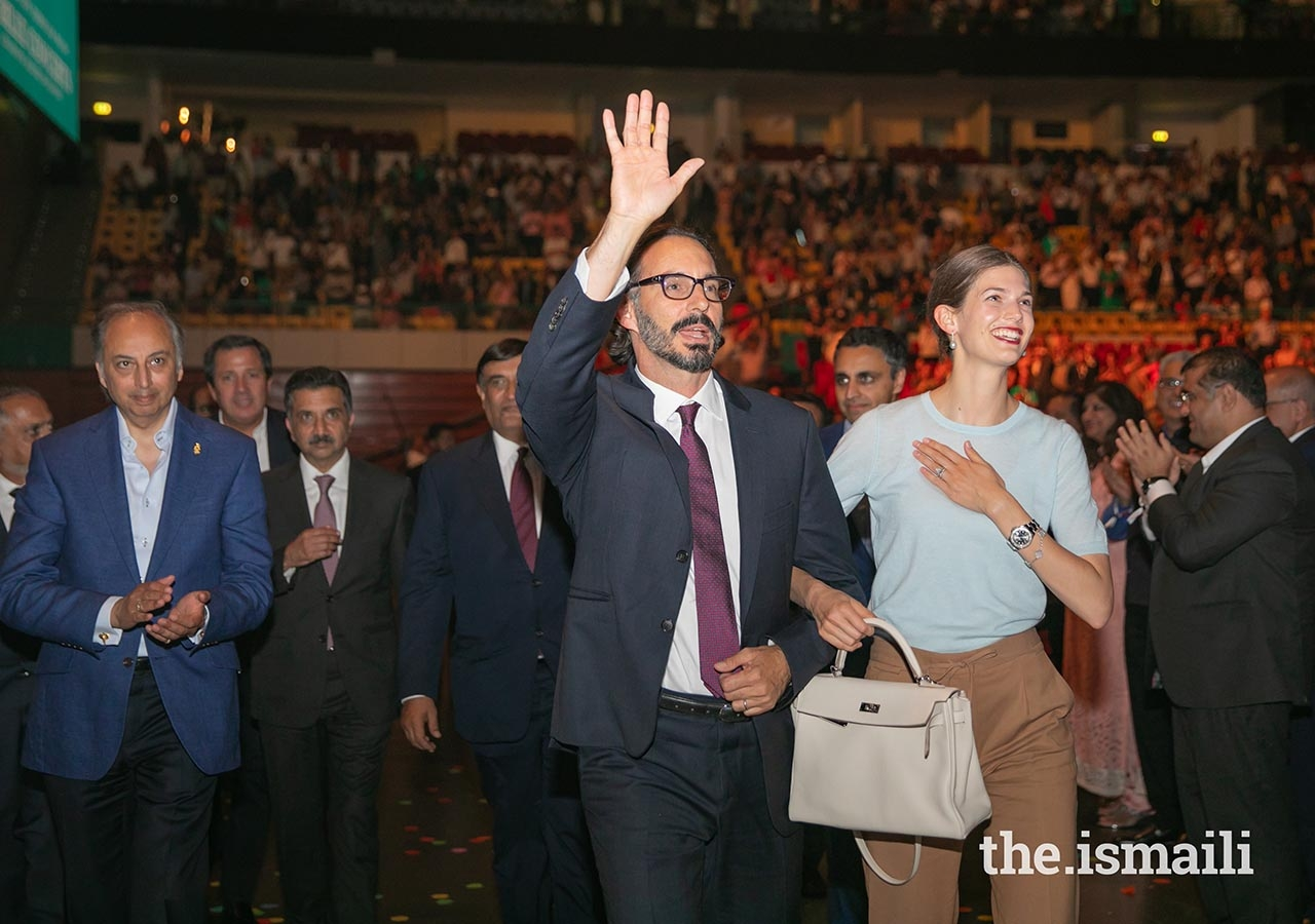Prince Rahim and Princess Salwa acknowledge the crowd as they depart from the Altice Arena after attending the Sufi Voyage concert.