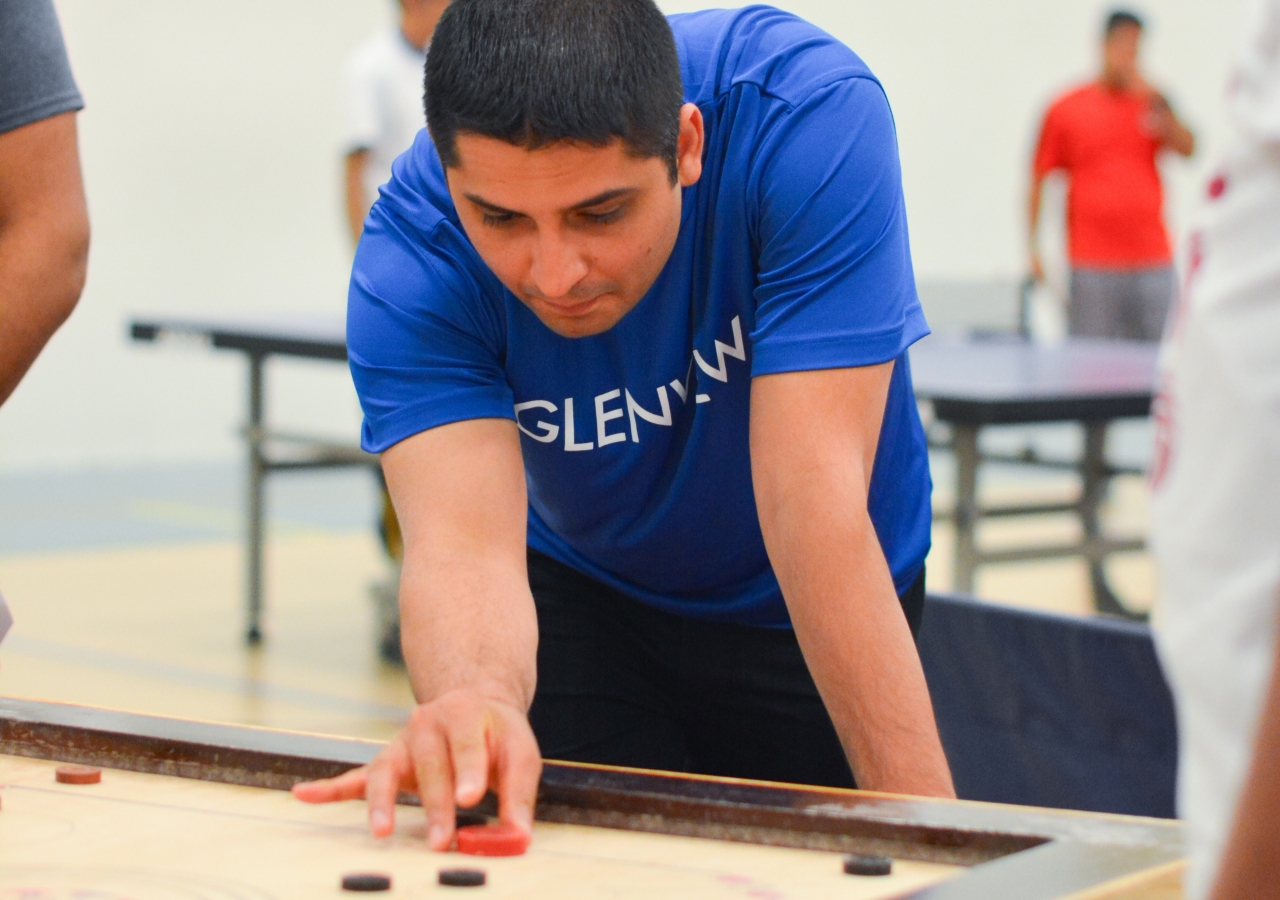 Anil Amlani concentrating on his next shot in Carom.